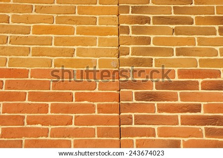 Wall with cladding tiles imitating bricks in sunny day  - stock photo