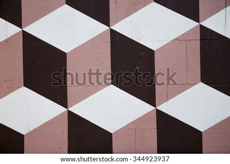wall with geometric pattern cube, white, beige, brown - stock photo