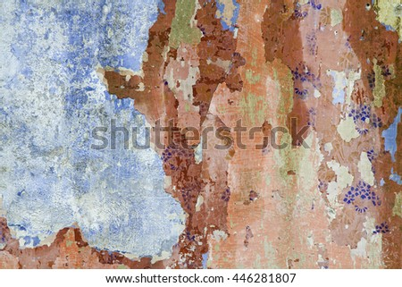 Wall with paint residues - Detail of a former now dilapidated apartment building in a small village of the Istrian peninsula - stock photo