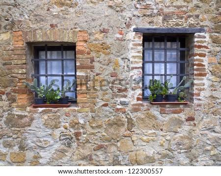 Wall with windows from Tuscany region of Italy. - stock photo