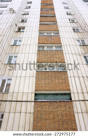 wall with windows multistory building - stock photo