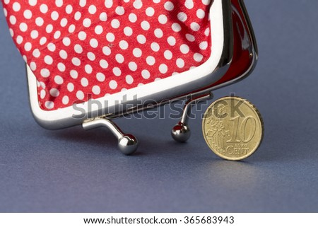 Wallet and last ten euro cent on blue background - stock photo