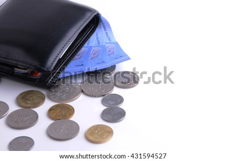 wallet full of money and coins - stock photo