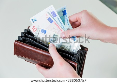 wallet with euro notes - stock photo