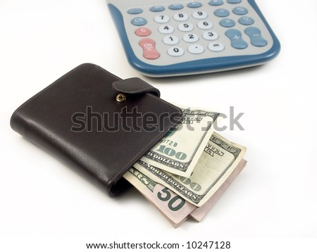 Wallet with hundred bills and calculator on white background - stock photo