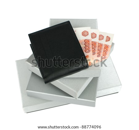 Wallet with Russian banknotes on silver gift boxes - stock photo