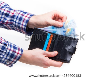 Wallet with Swiss francs - studio shoot  - stock photo