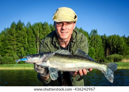 Walleye summer fishing in Scandinavia - stock photo