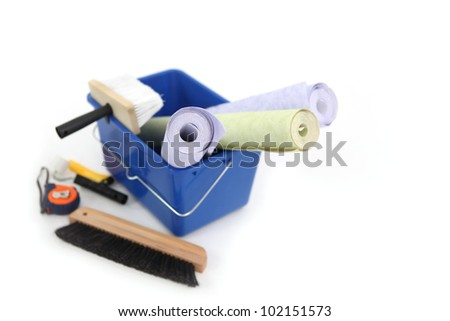 Wallpaper, bucket and brushes - stock photo