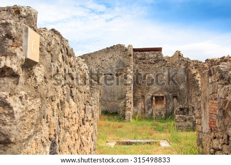 walls in Pompeii, Italy. Pompeii is an ancient Roman city died from the eruption of Mount Vesuvius in the 1st century. in Pompeii, Italy. - stock photo
