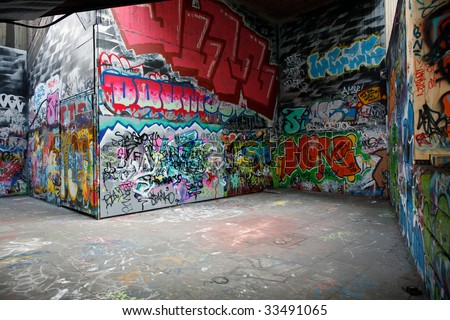 Walls painted with colorful graffiti - stock photo