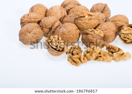 walnut and a cracked walnut isolated on the white background  - stock photo