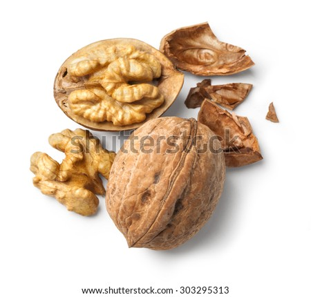 walnut and a cracked walnut isolated on the white background. with clipping path - stock photo