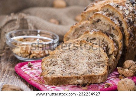 Walnut Bread (fresh baked) on dark vintage wooden background - stock photo