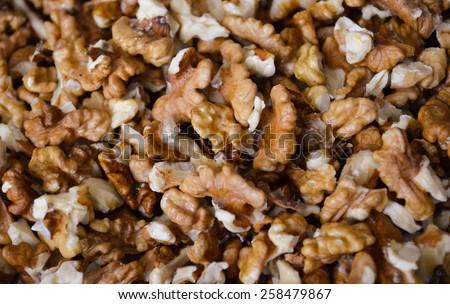 Walnut kernel snippets - stock photo