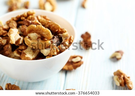 Walnut on a blue wooden table - stock photo