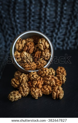 Walnut pieces inside in a porcelain bowl - stock photo