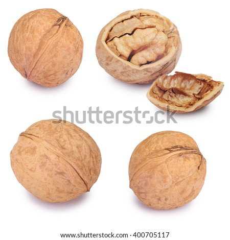 Walnut set and a cracked walnut isolated on the white background. Clipping Path - stock photo