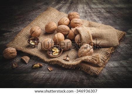 walnuts on jute - stock photo