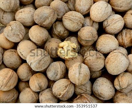 Walnuts whole in their skins, chopped, nut hulls, walnut kernels - stock photo