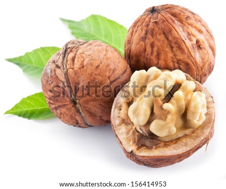 Walnuts with leaves isolated on a white background. - stock photo