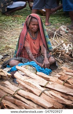 WAMENA, NEW GUINEA, INDONESIA - JANUARY 07: Unknown Papuan in everyday life in Wamena, New Guinea Island, Indonesia on January 07, 2009 - stock photo
