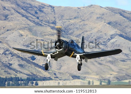 """WANAKA-MARCH 03: Corsair FG-1D aircraft takes off during the royal New Zealand air force 75th anniversary """"Warbirds Over Wanaka"""" airshow on March 03, 2012 in Wanaka New Zealand - stock photo"""