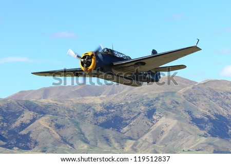"""WANAKA-MARCH 03: Grumman avenger aircraft flies over the mountains during the royal New Zealand air force 75th anniversary""""Warbirds Over Wanaka"""" airshow on March 03, 2012 in Wanaka New Zealand - stock photo"""