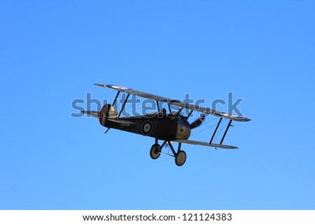 "WANAKA MARCH 03: Sopwith Camel Biplane vintage aircraft flies during the royal New Zealand air force 75th anniversary""Warbirds Over Wanaka"" airshow on March 03, 2012 in Wanaka New Zealand - stock photo"