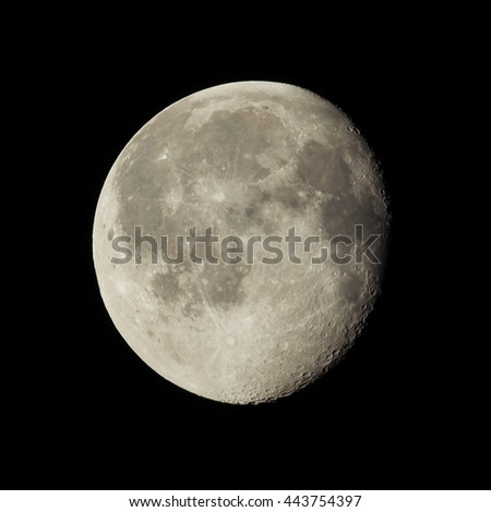 Waning gibbous moon, almost full moon, seen with an astronomical telescope (photo taken with my own telescope, no NASA images used) - stock photo