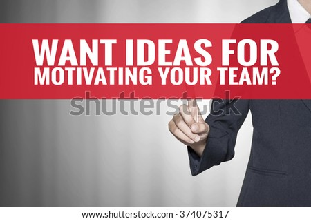 Want Ideas For Motivating Your Team word on virtual screen push by business woman red tab - stock photo