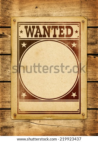 Wanted poster on a old wood board panel - stock photo