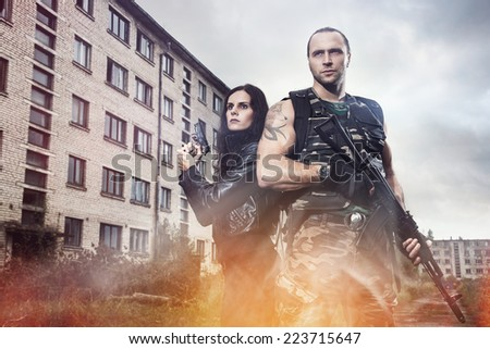 War, conflict. Guy with girl on a battlefield - stock photo