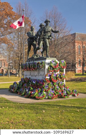 War memorial erected in Charlottetown, Prince Edward Island, Canada pictured after a Remerbrance Day service.  This monument was erected   after the WW1  to commemorate fallen soldiers from PEI. - stock photo