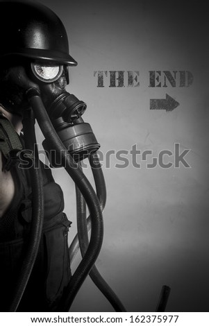 War, nuclear disaster, man with gas mask, protection - stock photo