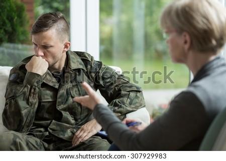 War veteran talking about problems during therapy - stock photo