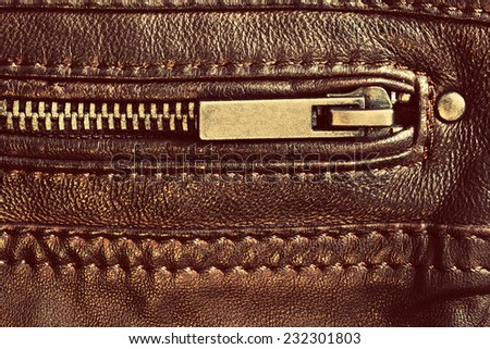 Wardrobe, clothing element, genuine brown leather with zip and seam. Background, pattern, texture. - stock photo