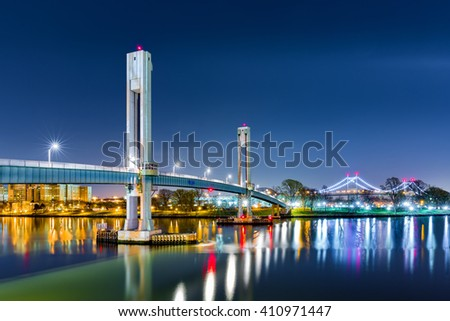 Wards Island pedestrian bridge crosses Harlem River to Wards Island NYC. RFK bridge further connects the island to Queens across East River. - stock photo