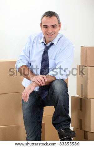 Ware house manager surrounded by boxes - stock photo
