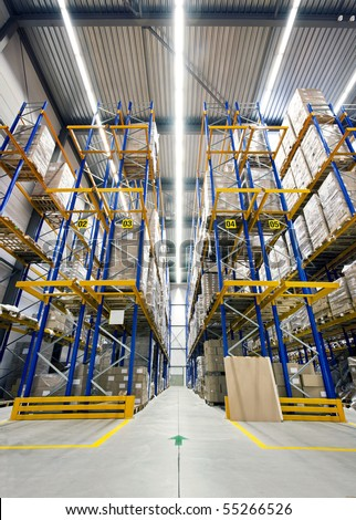 Warehouse with high racks, loaded with boxes, ready to be shipped to customers - stock photo