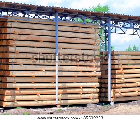 Warehousing cylindrical logs - stock photo