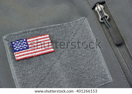 Warm Army or Soldier Coat Or Bag With American Flag Patch And Locked Zipper Closeup - stock photo