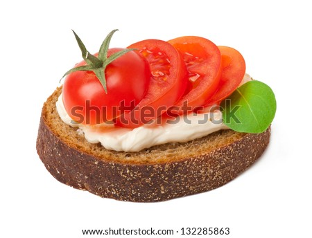 Warm bread tomatoes, cream cheese and basil isolated on white background - stock photo