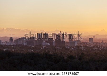 Warm dawn light on Century City and Beverly Hills with downtown Los Angeles in the background.   - stock photo