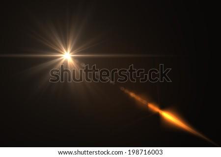 warm digital lens flare in black background horizontal frame - stock photo