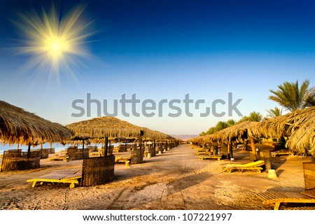 Warm empty  beach wait visitors early morning. - stock photo