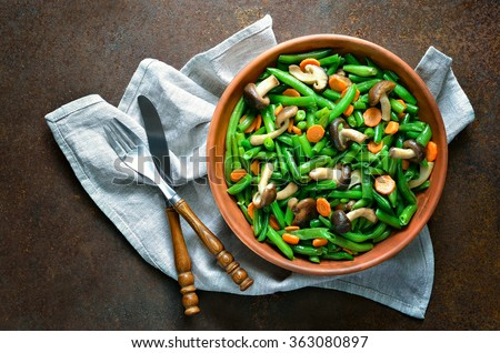 Warm green bean, carrot and mushroom salad, view from above - stock photo