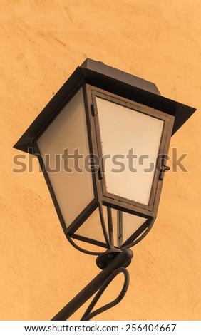 Warm lamps against cold lighting  - stock photo