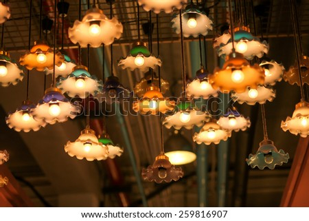 Warm lamps against cold lighting in a coffee shop - stock photo