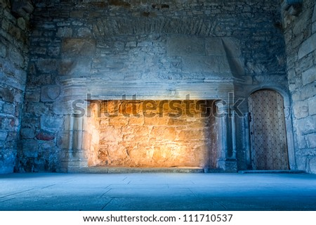 Warm light in a cold medieval castle - stock photo